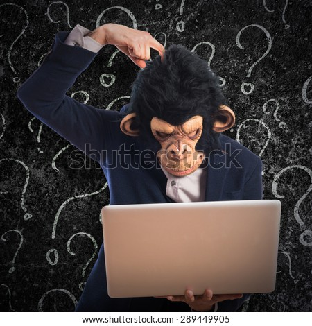 Monkey man having doubts with his laptop