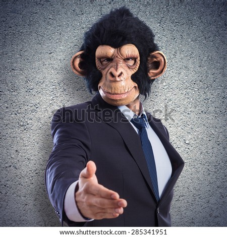 Monkey man making a deal over textured background