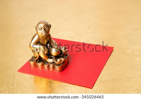 Monkey the symbol of the chinese new year 2016, and red envelope on a gold background - stock photo