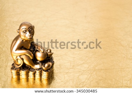Monkey  the symbol of the chinese new year 2016 on a gold background - stock photo