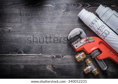 Monkey wrench brass plumbing fittings construction plans. - stock photo