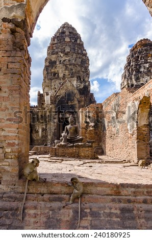 Monkeys with Buddha statues at Phra Prang Sam Yot in Lopburi, Thailand - stock photo