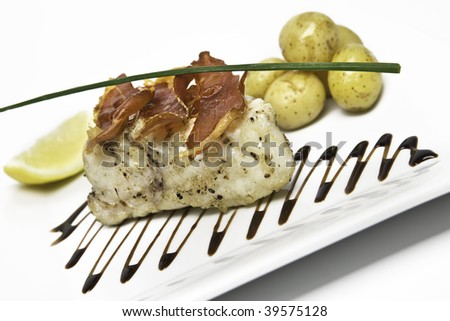 Monkfish tail with boiled potatoes and chive - stock photo
