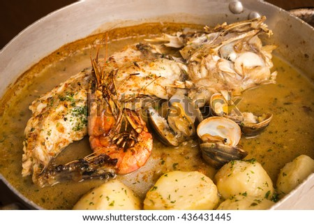 Monkfish with sauce and potatoes - stock photo