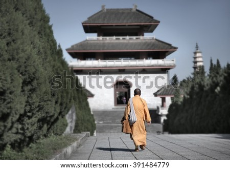 monks in temple  - stock photo