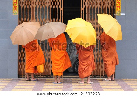 Monks on their daily tour in phnom penh - stock photo