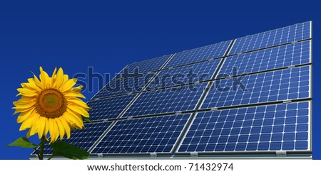 mono-crystalline solar panels and sunflower against a blue background - stock photo