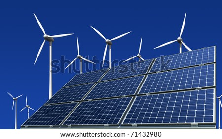 mono-crystalline solar panels and wind turbines against a blue background - stock photo