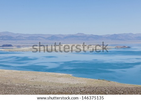 Mono Lake is a large, shallow saline lake in Mono County, California, The lack of an outlet causes high levels of salts to accumulate in the lake. - stock photo