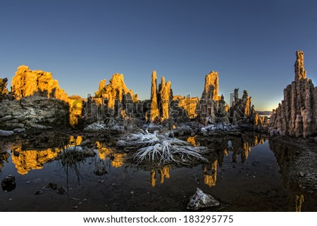 Mono Lake is one of California's most prominent photographic icons. The Tufas are dramatic rock spires protruding from the seabed. - stock photo