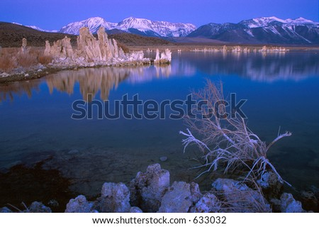 Mono Lake's limestone tufa formations at dawn with Sierra Nevada mountains in the background - stock photo