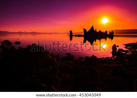Mono Lake Tufa Towers Reflection in the water at Sunrise Famous California Landscapes USA - stock photo