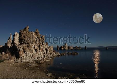 Mono Lake Tufas With the Moon at Night - stock photo
