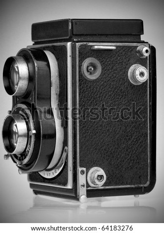 Monochromatic image of a vintage professional camera - stock photo