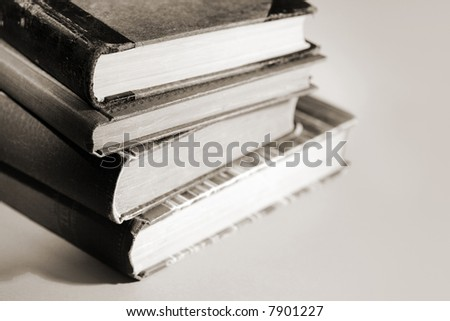 Monochromatic image of stacked old books