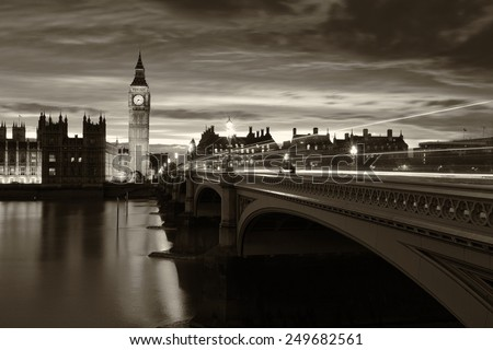 Monochrome Big Ben and London at night with the lights of the cars passing by after rain, London and England - stock photo
