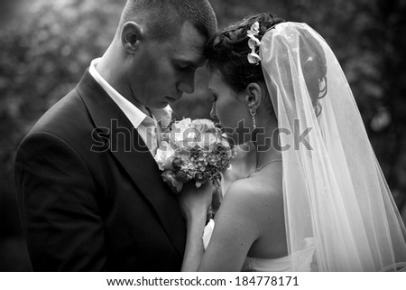 Monochrome closeup portrait head to head looking on bouquet - stock photo