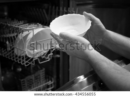 monochrome dishwasher door open - stock photo