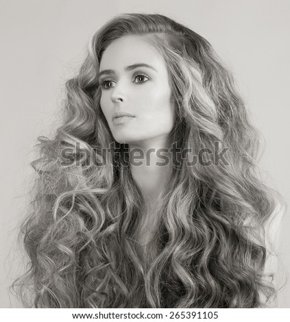 monochrome fashion portrait of beautiful young woman. hairstyle girl.a lot of hair