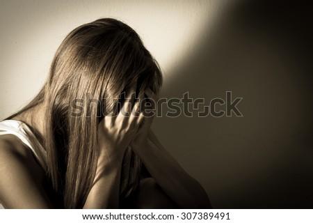 Monochrome filtered of sad girl,social problem concept. - stock photo