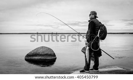 Monochrome fishing scenery - stock photo