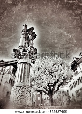 monochrome grunge vintage bottom-up representation of the fountain of Strength in the downtown of the swiss city of Fribourg (Neuveville area) - stock photo