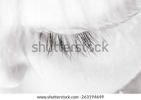 monochrome image close-up of eye of a sleeping child - stock photo