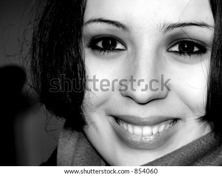 Monochrome image of a smiling young woman