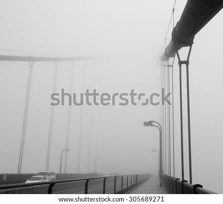 Monochrome, image of Golden Gate Bridge on a foggy summer morning - stock photo