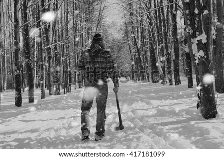 monochrome landscape man with axe - stock photo