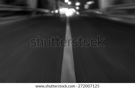 Monochrome motion blur of road, concept danger high speed movement on freeway  - stock photo