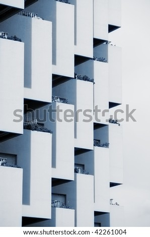 Monochrome pattern composed by residential balconies. - stock photo