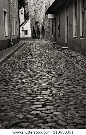 Monochrome photo of old european street. Tallinn, Estonia