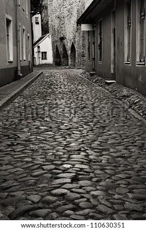 Monochrome photo of old european street. Tallinn, Estonia - stock photo