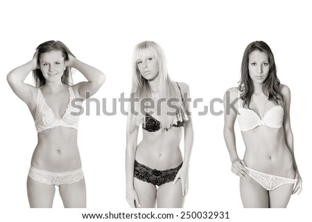 Monochrome photo of three attractive underwear models, isolated in front of white studio background - stock photo