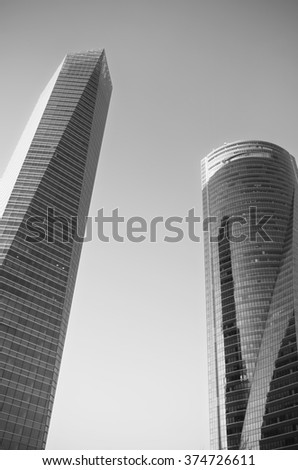 Monochrome picture of a modern abstract business center - stock photo