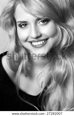Monochrome portrait of a cheerful blond young woman