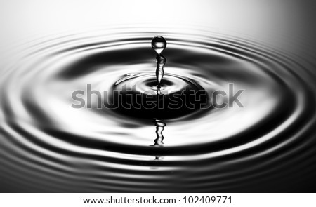 Monochrome reflected water drop - stock photo