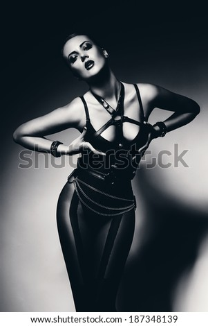 monochrome sexy woman holding her breasts - stock photo