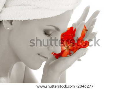 monochrome woman with red flower petals in spa - stock photo