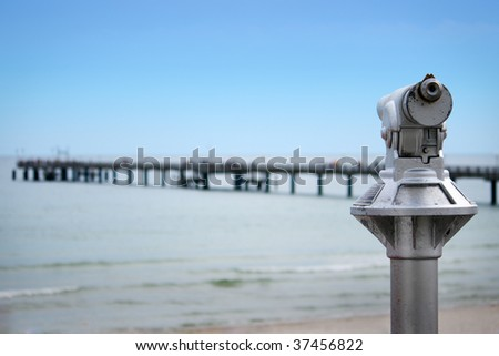 Monocular coin operated, background with sea bridge out of focus - stock photo