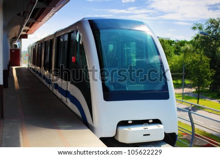 Monorail fast train on railway, close-up - stock photo