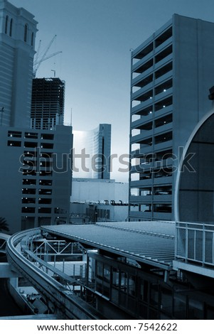 Monorail going around skyscrapers. Wide angle view. - stock photo