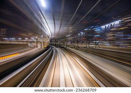 Monorail motion blur on the Yurikamome in Tokyo, Japan. - stock photo