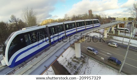 Monorail train on the railroad tracks in the city, aerial view - stock photo