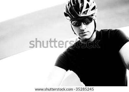 Monotone Closeup Photo Of A Serious Young Cyclist - stock photo