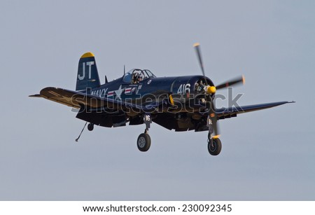 MONROE, NC - NOVEMBER 8, 2014:  A Corsair Fighter Aircraft Performing at the Warbirds Over Monroe Air Show in Monroe, NC.