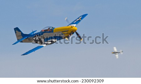 MONROE, NC - NOVEMBER 8, 2014:  Two P-51 Mustang Fighters Performing at the Warbirds Over Monroe Air Show in Monroe, NC.
