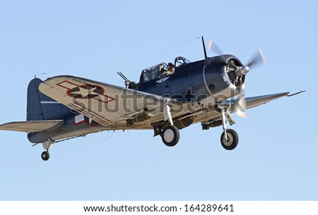MONROE, NC - NOVEMBER 10:  World War II Douglas Dauntless Dive-Bomber Performing during Warbirds Over Monroe Air Show in Monroe, NC, on November 10, 2013. - stock photo