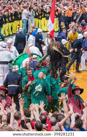 MONS, BELGIUM - JUNE 15, 2014: Combat of Saint George (Lumecon) within The Ducasse de Mons (Doudou) celebrations, recognized as one of the Masterpieces of the Oral and Intangible Heritage of Humanity. - stock photo